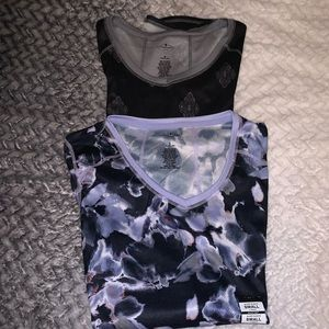 2 Women's athletic shirts